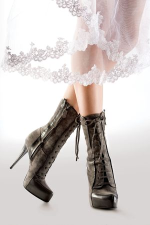 4081371 - elegant boots. a closeup view of the legs of a model wearing elegant boots.